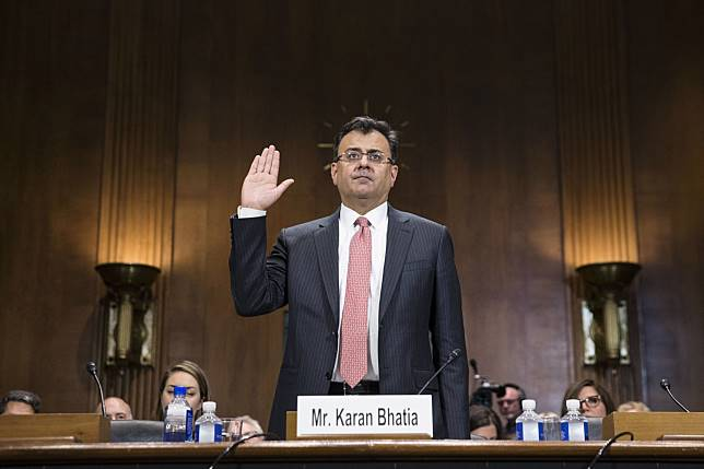 Karan Bhatia swears-in to a Senate Judiciary Committee Subcommittee hearing on July 16. Photographer: Sarah Silbiger/Bloomberg
