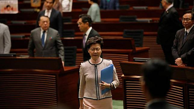 Hong Kong Chief Executive Carrie Lam reacts as lawmakers shout slogans, disrupting her annual policy address at the Legislative Council in Hong Kong, China, October 16, 2019. Lam was forced to halt her annual policy address on Wednesday after some lawmakers disrupted the session, shouting and jeering as she started her speech. REUTERS/Kim Kyung-Hoon