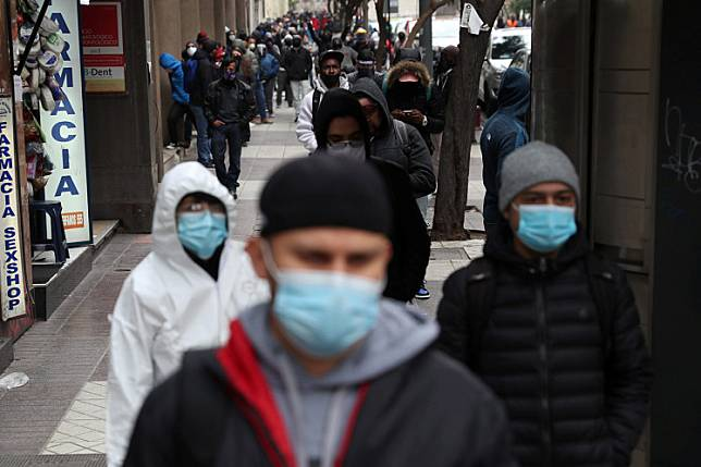 Unemployed people queue to apply for unemployment insurance outside of the office of an unemployment fund administrator, amid the spread of the coronavirus disease (COVID-19) in Santiago, Chile June 8.