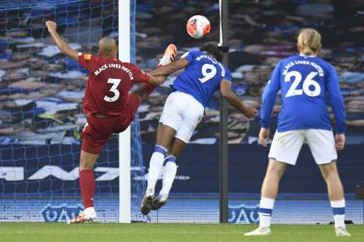 Everton's English striker Dominic Calvert-Lewin (C) heads a chance wide during the English Premier League football match between Everton and Liverpool at Goodison Park in Liverpool, north west England on June 21, 2020.The Premier League said on Wednesday that the 2020 summer transfer window will open for 10 weeks from July 27 and close on Oct. 5, with a domestic-only window for English Football League (EFL) clubs until Oct. 16.