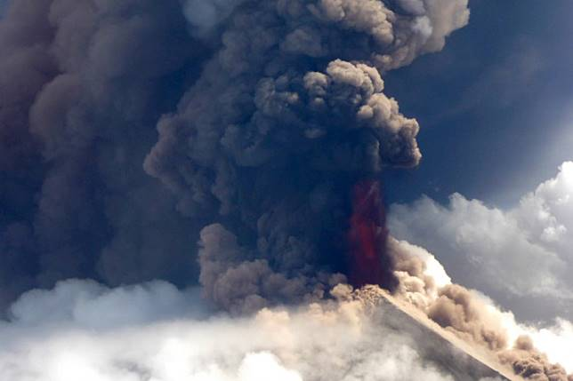 This handout from Niugini Helicopters taken and recieved on June 26, 2019 shows Papua New Guinea's Mount Ulawun volcano spewing lava. Papua New Guinea's volatile Ulawun volcano -- designated one of the world's most hazardous -- erupted on June 26, spewing lava high in the air and sending residents fleeing.