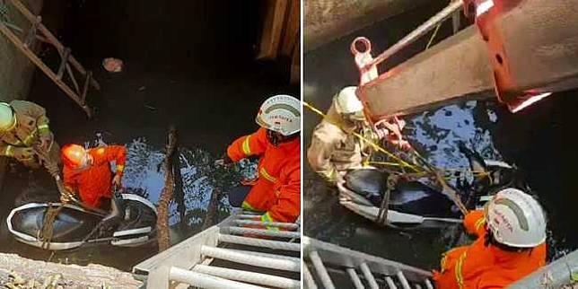 Evakuasi Yamaha NMax yang tercebur ke aliran sungai di Duren Sawit (Instagram/damkarjakartatimur)