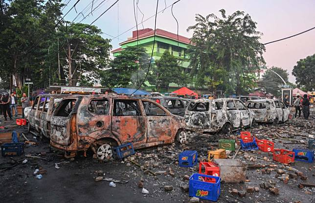 Cars that were burned by rioters are seen following overnight trouble near by the Elections Supervisory Agency (Bawaslu) in Jakarta on May 22.