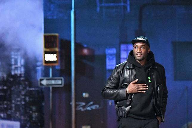 US designer for Louis Vuitton, Virgil Abloh, acknowledges the audience at the end of the Louis Vuitton men's Fall/Winter 2019/2020 collection fashion show in Paris on January 17, 2019.