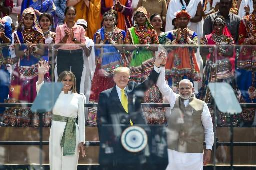 US First Lady Melania Trump, President Donald Trump and India's Prime Minister Narendra Modi wave at the crowd during 'Namaste Trump Rally' at Sardar Patel Stadium in Motera, on the outskirts of Ahmedabad, on Feb. 24, 2020. Prime Minister Narendra Modi has received an invitation from US President Donald Trump to attend the next Group of Seven summit, India's Foreign Affairs Ministry said on Tuesday.