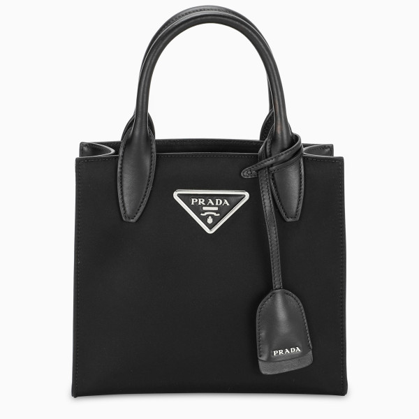 Handbag by Prada in black nylon and leather. Double top handle, detachable shoulder strap, tag and t