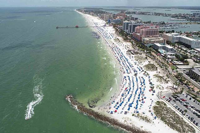 Sun seekers gather at Clearwater Beach, which remains open despite high numbers of COVID-19 infections in the state, on Independence Day in Clearwater, Florida, US July 4, 2020.