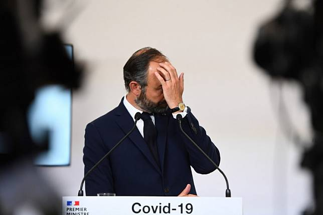 French Prime Minister Edouard Philippe reacts as he presents the details for the end of the country's lockdown, on May 7, 2020 at the Hotel Matignon in Paris, on the 52nd day of a strict lockdown in France to stop the spread of COVID-19.Philippe resigned on Friday ahead of a government reshuffle by President Emmanuel Macron designed to bolster his green credentials and win back disillusioned voters ahead of a possible re-election bid.