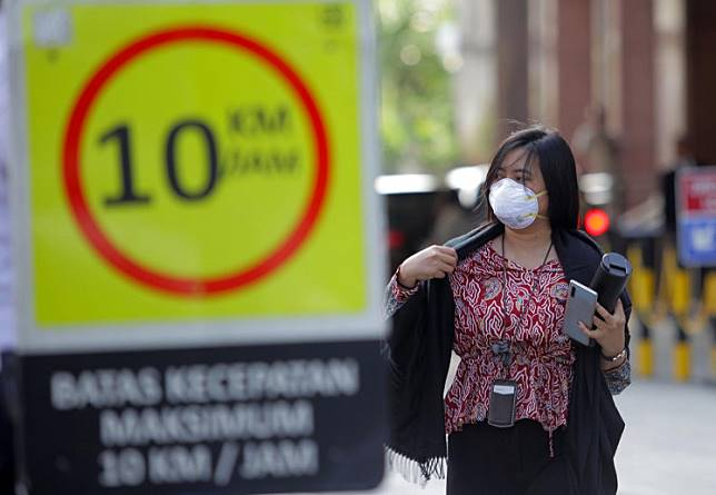 A woman wears a mask in Jakarta on Jan. 23.