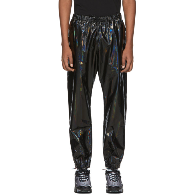 Tapered iridescent polyurethane lounge pants in black. Mid-rise. Three-pocket styling. Drawstring at