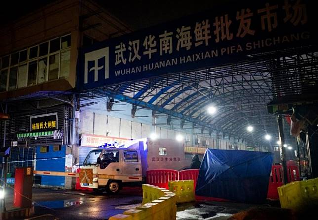 In this file photograph taken on January 11, 2020, members of staff of the Wuhan Hygiene Emergency Response Team drive their vehicle as they leave the closed Huanan Seafood Wholesale Market in the city of Wuhan, in Hubei, Province, where the Wuhan health commission said that the man who died from a respiratory illness had purchased goods. A second person has died in China from a mystery virus that has stricken dozens and appeared in two other Asian countries, officials said.