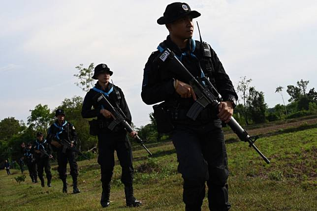 This photo taken May 23, 2019 shows Thai military rangers conducting a foot patrol along the Mekong river bordering Thailand and Laos in Ban Paeng, Nakhon Phanom province.Thailand ordered security stepped up at its land borders on Monday after concerns surged over a possible second wave of coronavirus infections, following the arrests of thousands of illegal migrants in the past month.