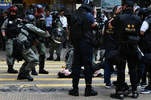 สำนักงานกิจการฮ่องกงและมาเก๊า เรียกร้องให้ทางการฮ่องกงใช้กฎหมายให้เข้มงวดขึ้นในการจัดการกับผู้ประท้วงเรียกร้องประชาธิปไตยในฮ่องกง Anthony WALLACE / AFP