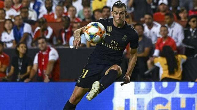 Attacker Real Madrid, Gareth Bale (kiri) tampil pada laga International Champions Cup 2019 (ICC 2019) kontra Arsenal di FedExField, Maryland, Amerika Serikat, Rabu (24/7/2019) pagi WIB. [ANDREW CABALLERO-REYNOLDS / AFP]