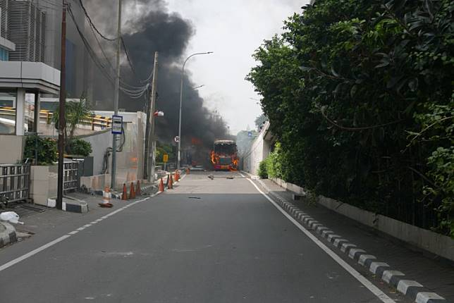 Black smoke rises from a fire in Slipi, West Jakarta, on Wednesday afternoon, May 22, during post-election riots that started on Tuesday night.