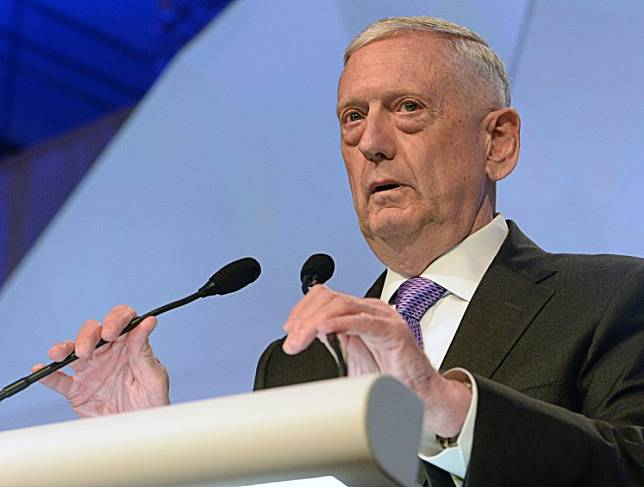US Pentagon chief Jim Mattis delivers his speech during the first plenary session at the 16th Institute for Strategic Studies (IISS), Shangri-La Dialogue Summit in Singapore on June 3, 2017.Mattis issued a stinging rebuke of his erstwhile boss Donald Trump on Wednesday, accusing the president of trying to