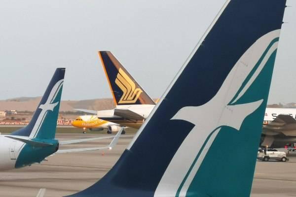 Pesawat milik maskapai Scoot, Singapore Airlines, dan Silk Air terlihat di Bandara Changi, Singapura, Selasa (14/8/2018)./Reuters-Edgar Su