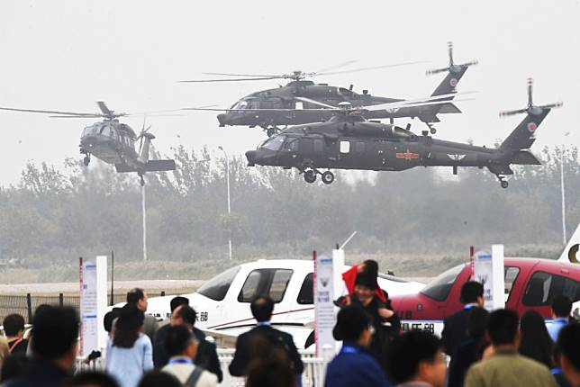 China's Z-20 Black Hawk lookalike and flying saucer concept craft star at helicopter expo