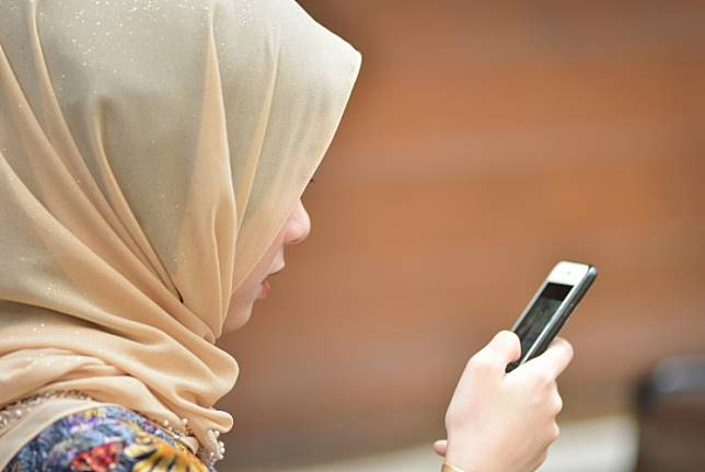 A woman uses her phone.