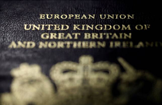 The close-up detail of the cover of a European Union British passport is seen in Paris on January 23, 2013.