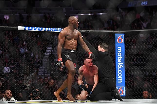 UFC 245: Kamaru Usman TKOs Colby Covington in final minute of dramatic slugfest