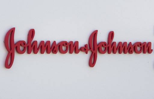 In this file photo taken on Aug. 28, 2019 an entry sign to the Johnson & Johnson campus shows their logo in Irvine, California. Johnson & Johnson said on Monday it had selected a lead candidate vaccine for the new coronavirus that would move to human trials by September and could be ready for emergency use by early next year.