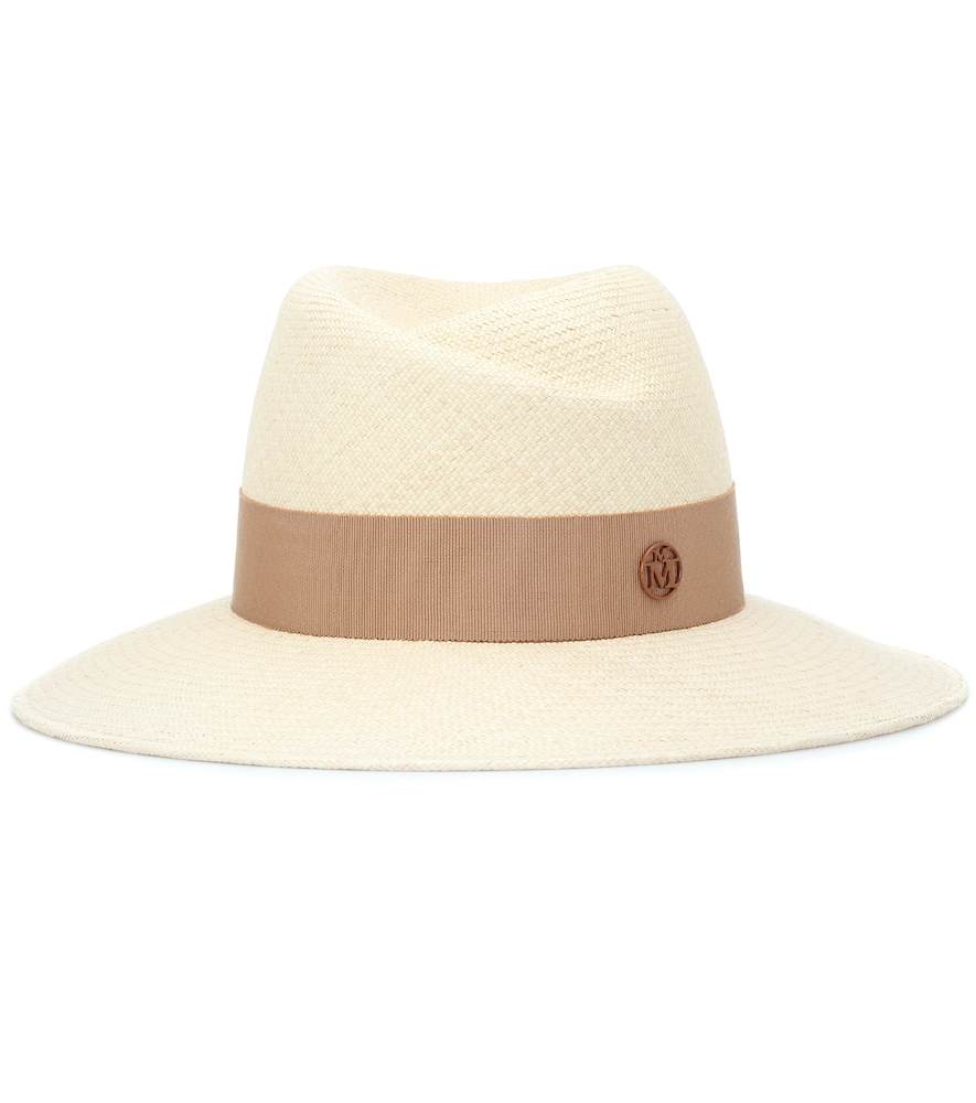 Maison Michel renders its iconic Virginie hat in beige straw for a fresh take on sunshine style.