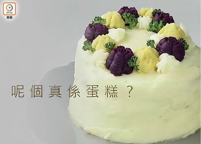 造型好似忌廉蛋糕,但內有乾坤,原來是芝士漢堡扒。(互聯網)