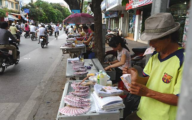 In a picture taken on July 16, 2012, vendors display lottery tickets for sale in Hanoi.Vietnamese police have smashed a massive online card ring with revenues estimated at $2.6 billion, the biggest ever bust of its kind in a country where most gambling is banned but remains rampant.