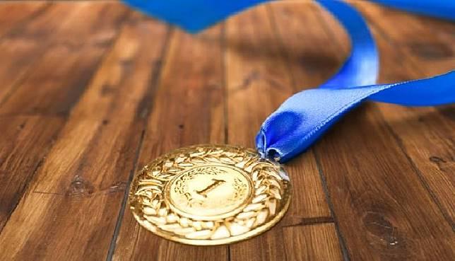 Illustration of a gold medal award. Kredit: SHUTTERSTOCK/KOMUNIKA ONLINE