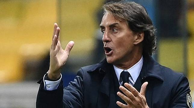Pelatih Timnas Italia, Roberto Mancini. [Marco BERTORELLO / AFP]
