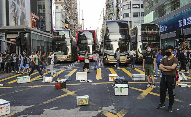 Anti-government protesters vow to stick with new strategy after increased weekday violence brings Hong Kong to partial standstill