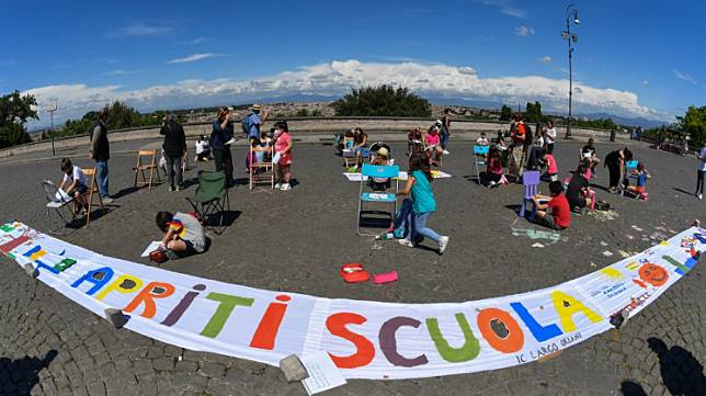 Parents and children from Rome's public primary and secondary school IC Largo Oriani take part in a flashmob entitled