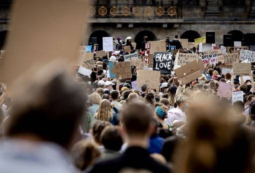 Protesters demonstrate on June 1, 2020, in Amsterdam, to protest against the police killing of unarmed black man George Floyd in the USA. The United States has erupted into days and nights of protests, violence, and looting, following the death of George Floyd after he was detained and held down by a knee to his neck, dying shortly after.
