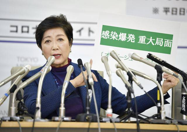 Tokyo Governor Yuriko Koike attends an emergency news conference on the spreading of coronavirus disease (COVID-19) in Tokyo, Japan March 25, 2020. Koike said on Friday that Japan declaring a national state of coronavirus emergency would send a