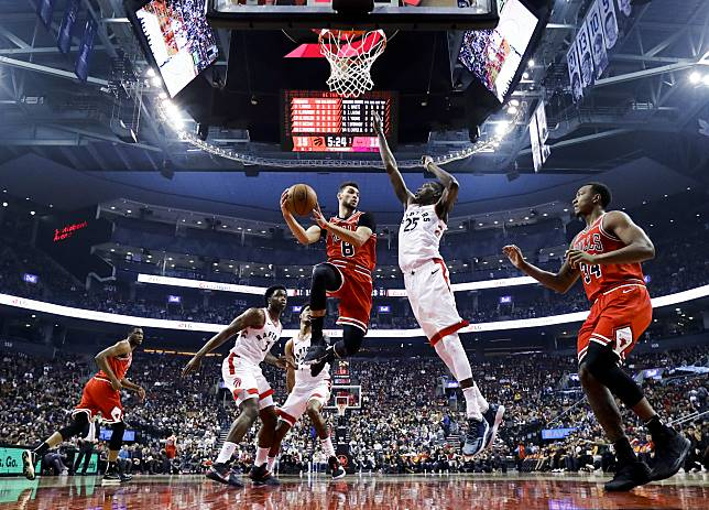 Bulls' Zach LaVine drives to the hoop during a preseason game against the Raptors on Oct. 13.