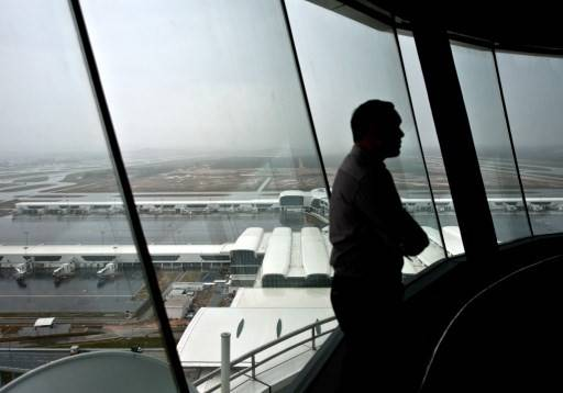 A Malaysian airport employee stands inside the new air traffic control (ATC) tower at the soon-to-be inaugrated low-cost carrier terminal at Kuala Lumpur International Airport 2 (KLIA2) in Sepang outside Kuala Lumpur on April 24, 2014. KLIA2 is scheduled to official open on May 2.