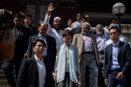 Hong Kong's Chief Executive Carrie Lam (C) exits the Kowloon Mosque, or Kowloon Masjid and Islamic Centre, in the Tsim Sha Tsui district in Hong Kong on October 21, 2019. Lam and the city's chief of police visited a mosque that was struck with blue dye from a water cannon truck during the latest bout of violent protests in the international hub.