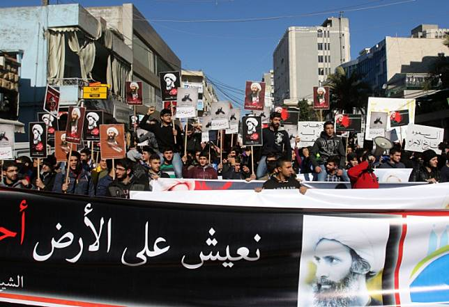 Lebanese college students take part in a demonstration on January 13, 2016 in the southern Lebanese city of Nabatiyeh, against the execution of prominent Shiite Muslim cleric Nimr al-Nimr by Saudi authorities.  Saudi Arabia on January 2 executed 47 men convicted of