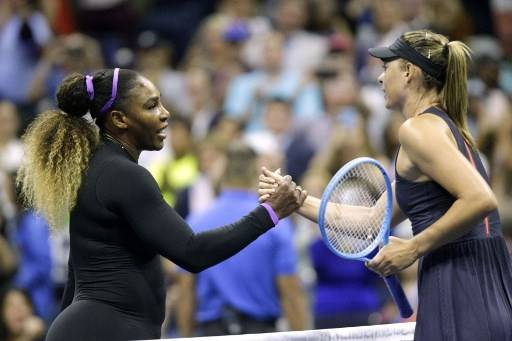 Maria Sharapova (R) of Russia shake hands after losing against Serena Williams of the United Sates during their Round 1 women's Singles match at the 2019 US Open at the USTA Billie Jean King National Tennis Center in New York on Aug. 26, 2019.