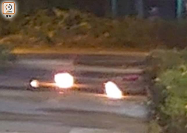 黑衣人向警署投擲汽油彈。