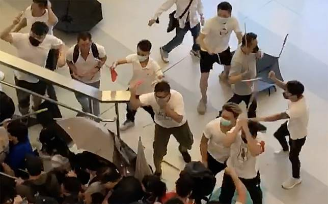 At least 36 injured as rod-wielding mob dressed in white rampages through Yuen Long MTR station, beating screaming protesters