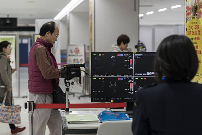 A health worker monitors a thermal scanner at Narita airport in Japan on Jan. 17.