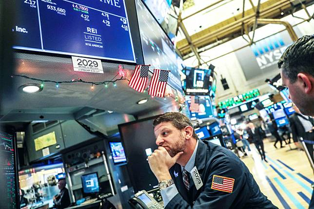 Play the market: Traders work on the floor of the New York Stock Exchange (NYSE) in New York on Wednesday. Global stocks surged following a dramatic rebound on Wall Street.