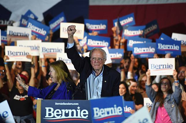 US 2020 Democratic presidential candidate Senator Bernie Sanders lifts his fist at a campaign rally in San Antonio, Texas on Feb. 22, 2020.