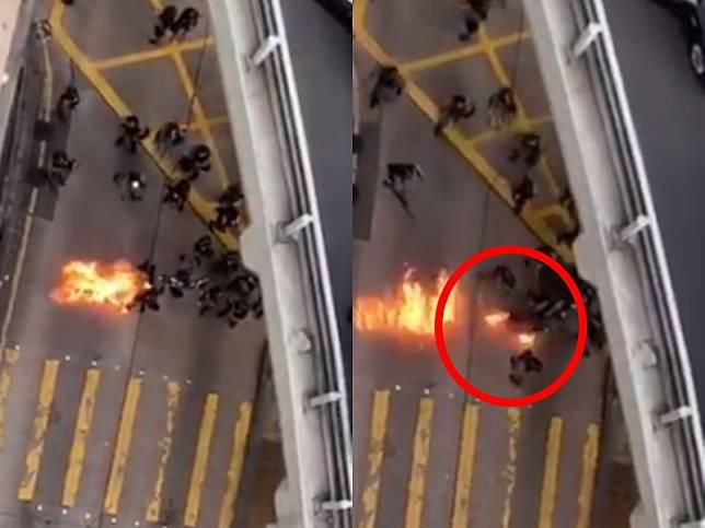 防暴警(紅圈)被濺中雙腳起火。影片截圖