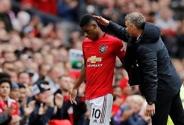 Pemain Manchester United Marcus Rashford dan pelatih Ole Gunnar Solskjaer. REUTERS/Phil Noble