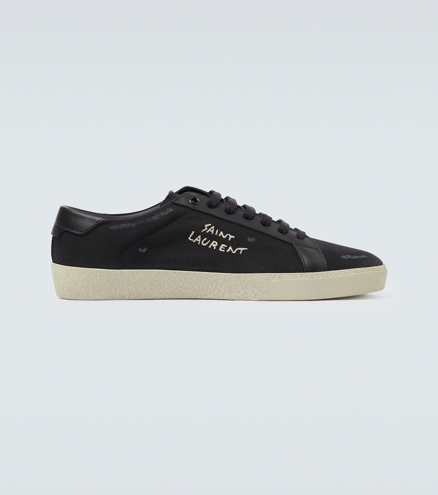 Crafted from black canvas uppers, these low-top sneakers from Saint Laurent feature leather trims, a