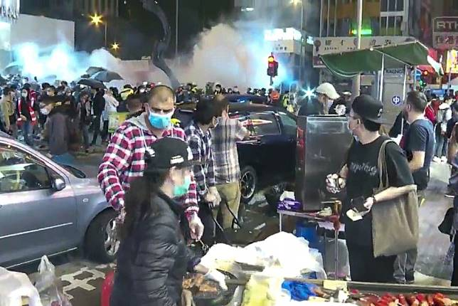 Hong Kong protests: tear gas fired on first day of the Lunar New Year as crowd gathers to mark fourth anniversary of Mong Kok riot
