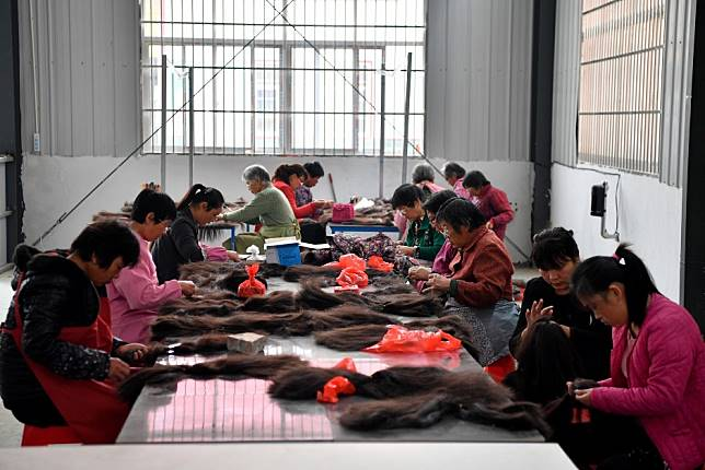 China's 'wig capital' has designs on Africa as US tariffs loom